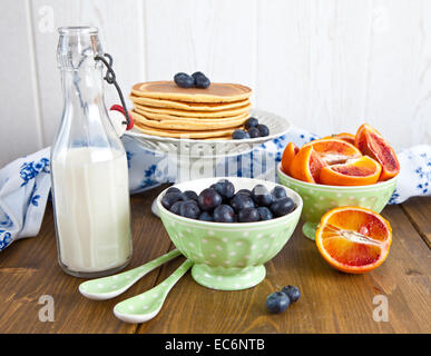 Breakfast with fresh fruits - Stock Photo