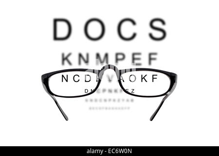 Eyeglasses over blurry background of letters - Stock Photo