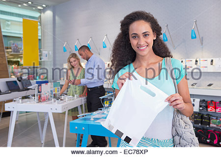 Woman with purchase in phone store - Stock Photo