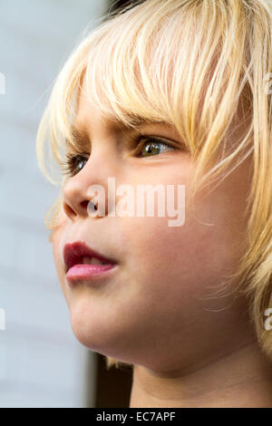 Portrait of little girl watching something - Stock Photo