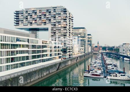 Germany, Cologne, crane houses and marina - Stock Photo