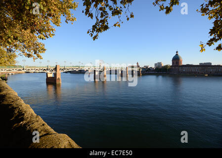 River Garonne and Pont Saint Pierre Bridge with Dome of Saint Joseph Chapel Toulouse Haute-Garonne France - Stock Photo