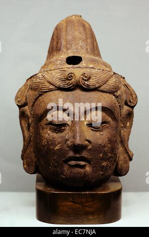 Cast iron head of Buddha, China, Yuan or Ming Dynasty, (circa 1300-1400).  This sculpture demonstrates the height - Stock Photo