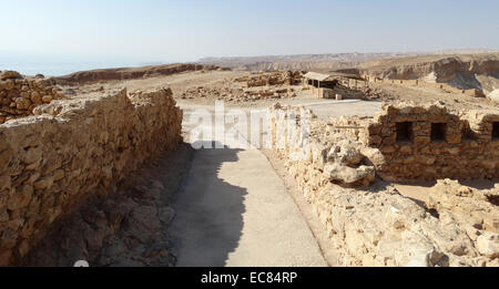 Masada is an ancient fortification in the Southern District of Israel situated on top of an isolated rock plateau - Stock Photo