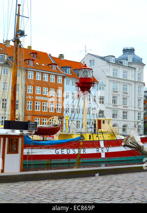 Nyhavn (New Harbour); a 17th-century waterfront; canal and entertainment district in Copenhagen; Denmark. - Stock Photo