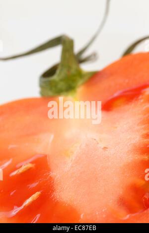 red tomato close-up cropped, studio shot - Stock Photo