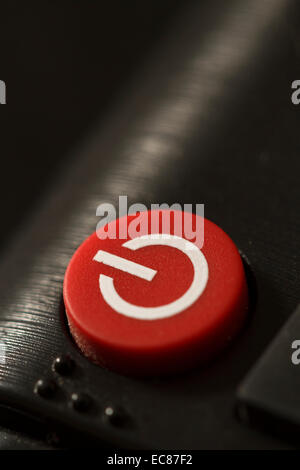 remote control on off button close-up macro shot - Stock Photo