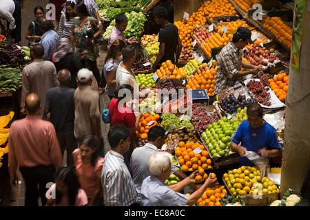 Mauritius, Port Louis, Central Market, shoppers in fruit section - Stock Photo