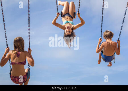 LOS ANGELES, CA – JULY 11 : Children swing looking out over the ocean in Los Angeles, California on July 11, 2014. - Stock Photo