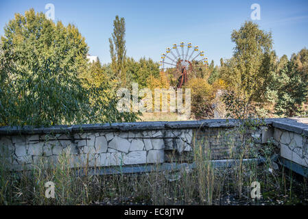 Ferris wheel seen from Energetik Palace of Culture in Pripyat abandoned city, Chernobyl Exclusion Zone, Ukraine - Stock Photo
