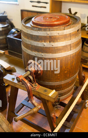 Old fashioned barrel butter churn, The Museum of  Folklore, Bruges, Belgium, Europe - Stock Photo