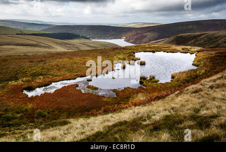 The Mermaid's Pool with Kinder Reservoir in the distance below Kinder Scout in the Derbyshire Peak District - Stock Photo