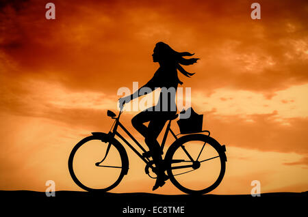 A Girl On A Bike At Sunset - Stock Photo