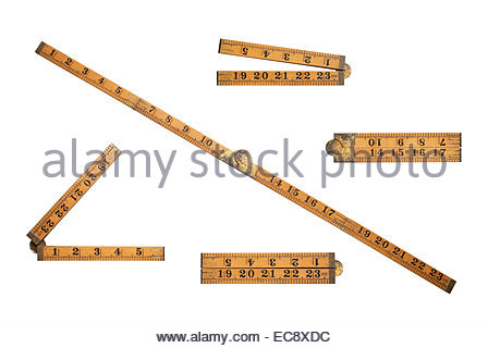 Different views of an old wooden folding ruler as used by carpenter Isolated on white with clipping path - Stock Photo