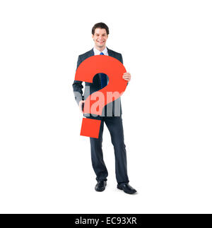 A Cheerful Business Man Holding a Question Mark - Stock Photo