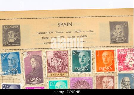 An old fully illustrated stamp album with stamps from Spain - Stock Photo