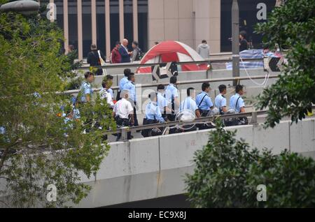 Hong Kong, China. 11th December, 2014. After 74 days of the Occupy Hong Kong protest, police enact a court injunction - Stock Photo