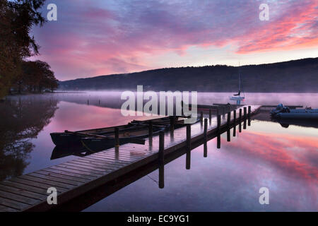 Jetty and Boats at Dawn Coniston Water near Coniston Lake District Cumbria England - Stock Photo
