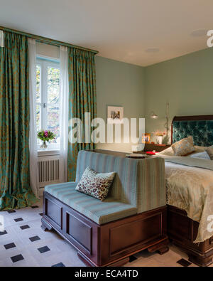Aquamarine Velvet Buttoned Headboard On Bed In Bedroom With Green ...
