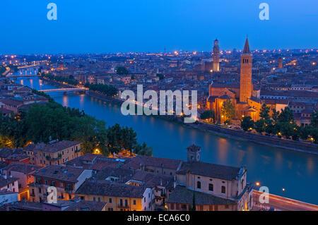 Santa Anastasia church and Torre de Lamberti at dusk, Adige river, Verona, Veneto, Italy, Europe - Stock Photo