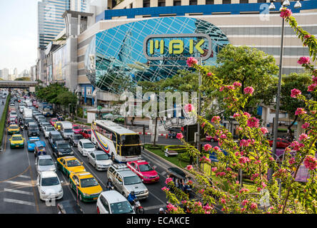 Streetscape with traffic jam in the city centre in front of the MBK Building, Bangkok, Thailand - Stock Photo