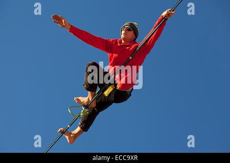 Man highlines in Crestline, Calif. - Stock Photo