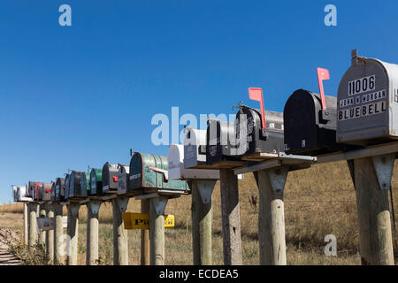 Line of Mailboxes (letterboxes) on Rural Dirt Road, South Dakota, USA - Stock Photo