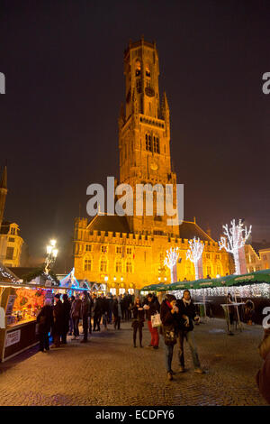 Bruges christmas market in the markt ( market ) square, city centre, with the belfry at night, Bruges, Belgium Europe - Stock Photo