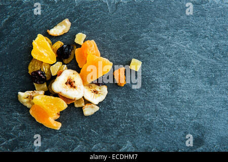 Closeup on mix of dried fruits on stone substrate - Stock Photo