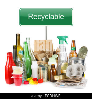 A selection of garbage for recycling. Segregated metal, plastic, paper and glass on white background - Stock Photo
