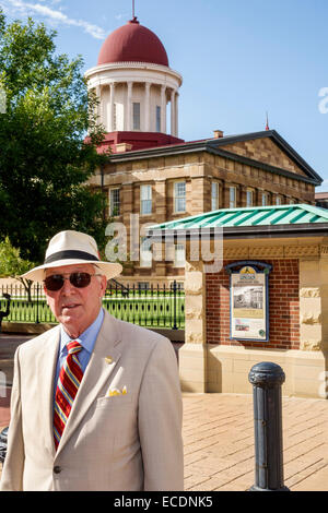 Springfield Illinois downtown historic buildings Old State Capitol Plaza building senior man wearing suit fedora - Stock Photo