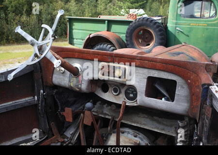 An old car with decaying interiour - Stock Photo