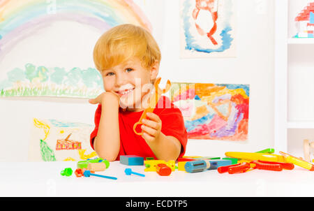 Handsome blond boy with wrench in kindergaten - Stock Photo
