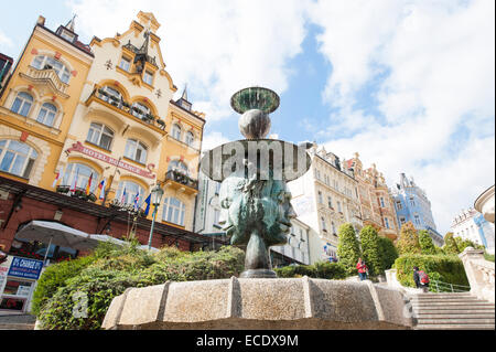 Fountain in front of Hotel Romance in Karlovy Vary (Karlsbad), Czech Republic - Stock Photo