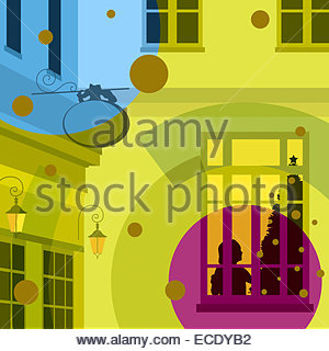 Silhouette of person decorating Christmas tree in window - Stock Photo