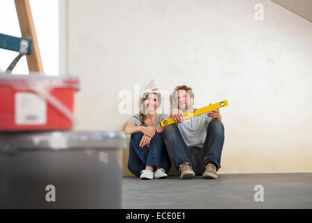 Taking a break couple new home planning - Stock Photo