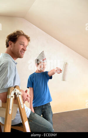 Father young boy painting decorating room happy - Stock Photo