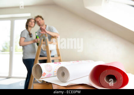 Couple planning new home drinking beer - Stock Photo