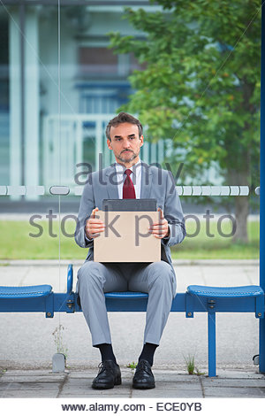 Depressed man suit unemployed fired sacked jobless - Stock Photo