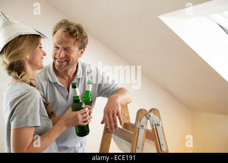 Couple drinking beer relaxing taking a break - Stock Photo