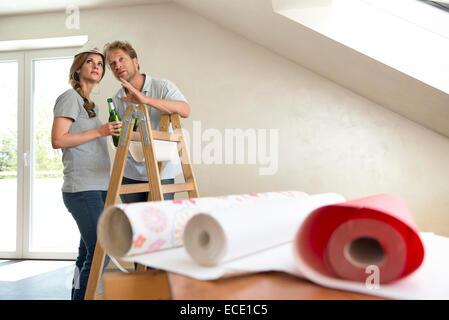 Man woman taking a break wallpaper - Stock Photo