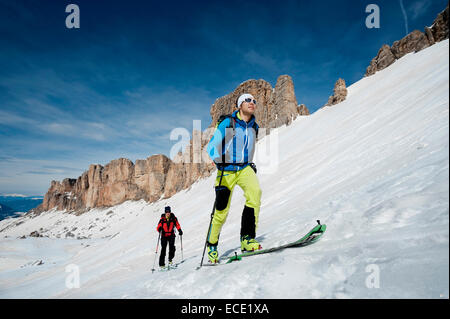 Men on a ski tour, Santa Cristina, Valgardena, Alto Adige, Italy - Stock Photo