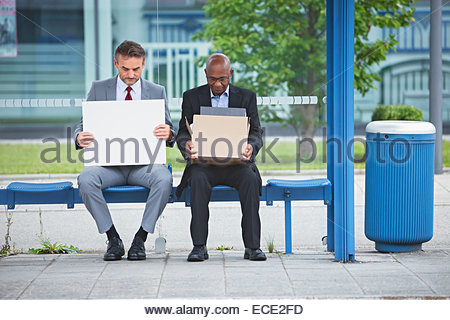 Businessmen notice of termination insolvent shame - Stock Photo