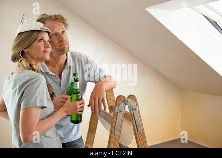 Taking a break new home renovating couple - Stock Photo