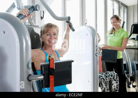 Mature woman fitness trainer studio practicing - Stock Photo