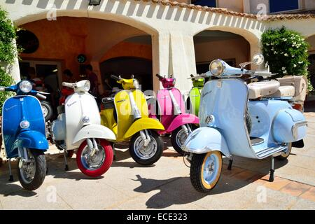 Colourful Vespa scooters, old and new models, Province of Olbia-Tempio, Sardinia, Italy - Stock Photo