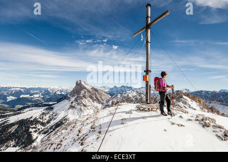 Mountaineer on the summit of Mt Tullen, Val di Funes, Mt Peiterkofel at the back, Dolomites, Funes, Eisacktal valley - Stock Photo