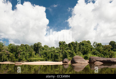 Bordered by rain forest, granite rocks, and sandy beaches: the Suriname River in Upper Suriname - Stock Photo