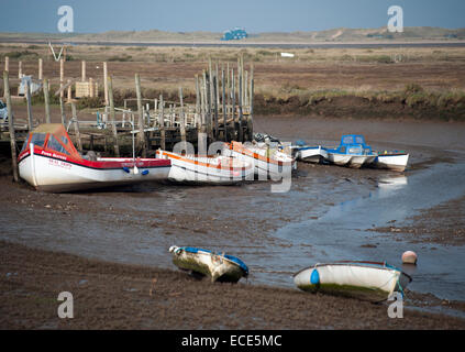 boats aground at low tide morston quay north norfolk england - Stock Photo