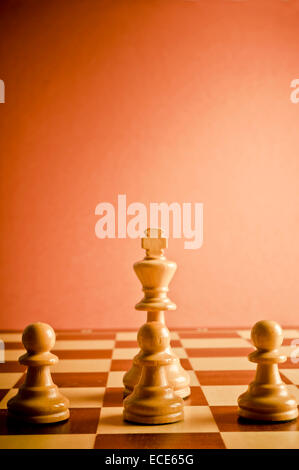 chess king and pawns, concept for teamwork and cooperation - Stock Photo